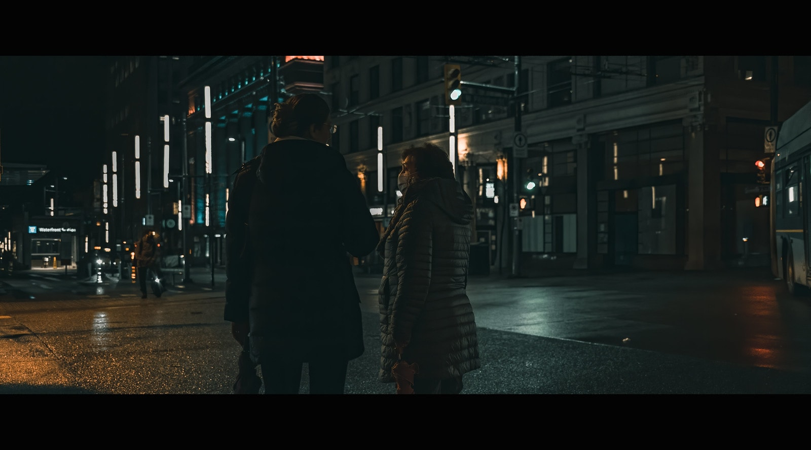 Couple strolling downtown at night