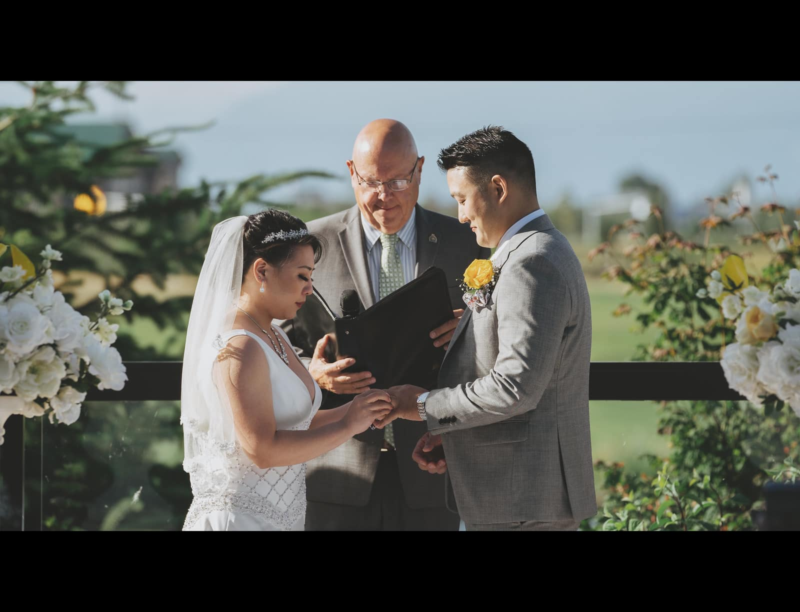 Couple exchanging rings, wedding ceremony