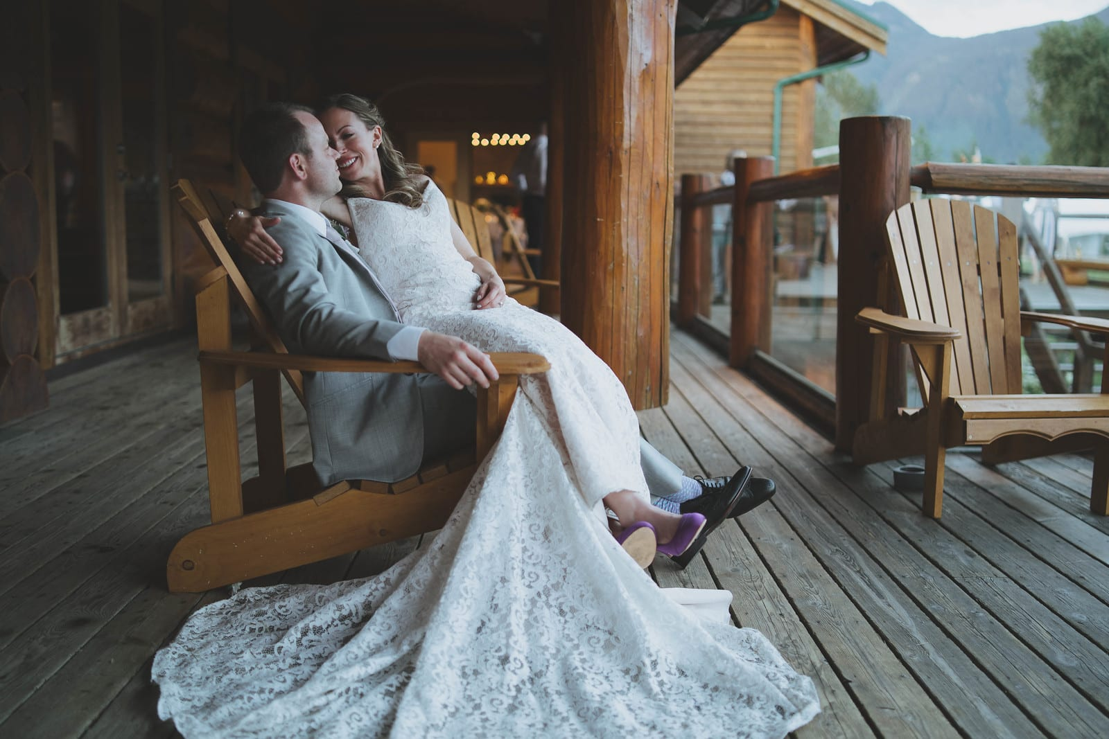 Couple sitting in adirondack chair sharing a moment